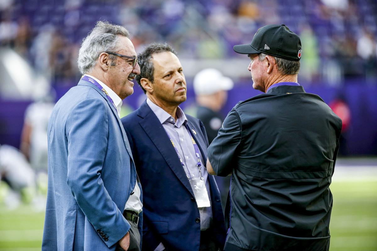 Vikings owners Zygi Wilf, Mark Wilf and Vikings coach talk before a game in 2019