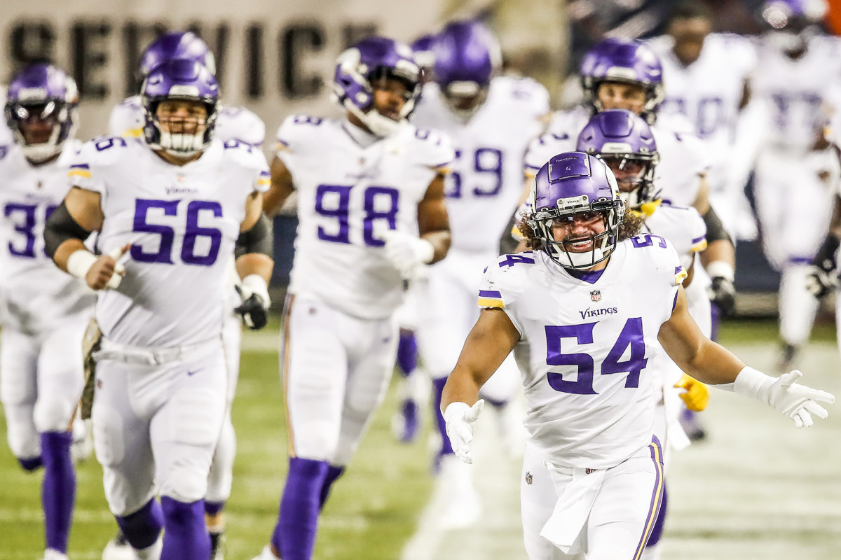 Eric Kendricks leads the Vikings onto the field for a road game
