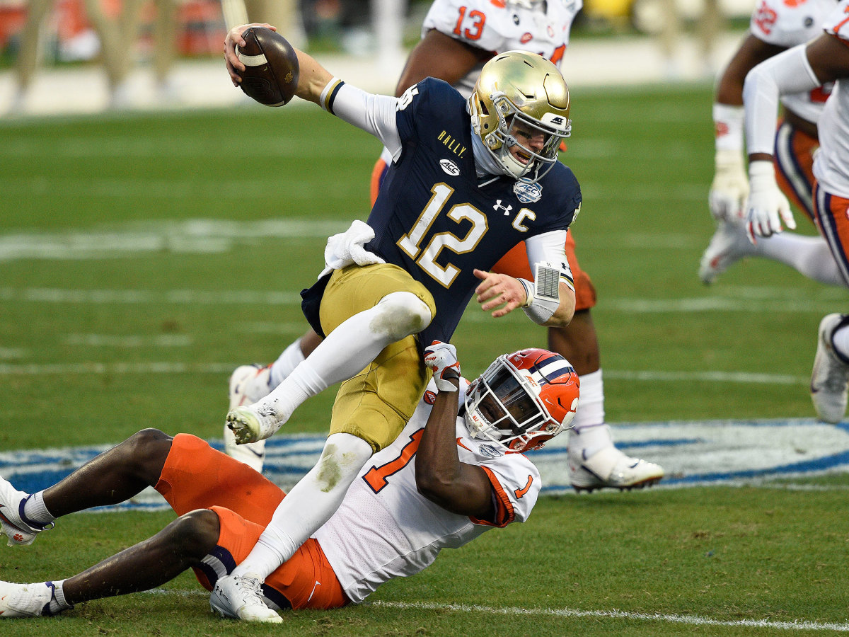 Notre Dame QB Ian Book is sacked by the Clemson defense