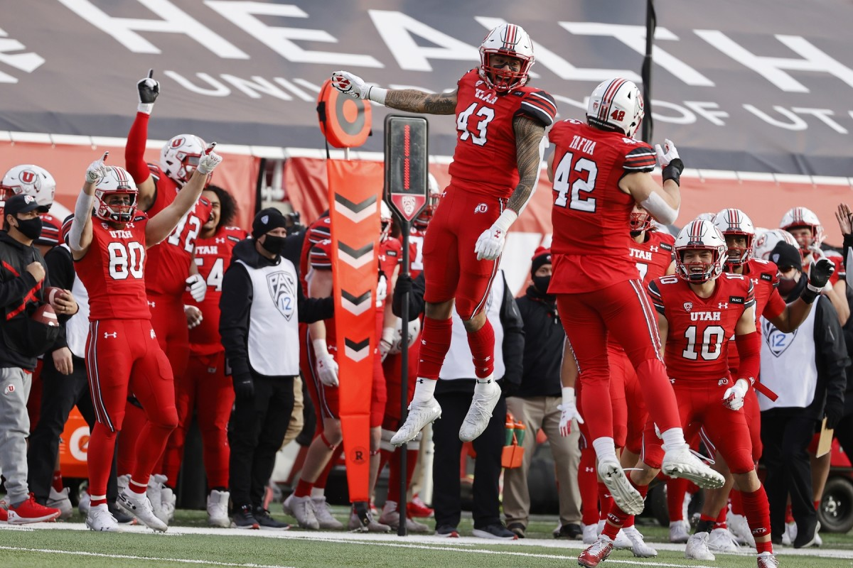 Dec 19, 2020; Salt Lake City, Utah, USA; Utah Utes tight end Mufi Hill-Hunt (43) and defensive end Mika Tafua (42) celebrate after a turnover in the fourth quarter against the Washington State Cougars at Rice-Eccles Stadium.