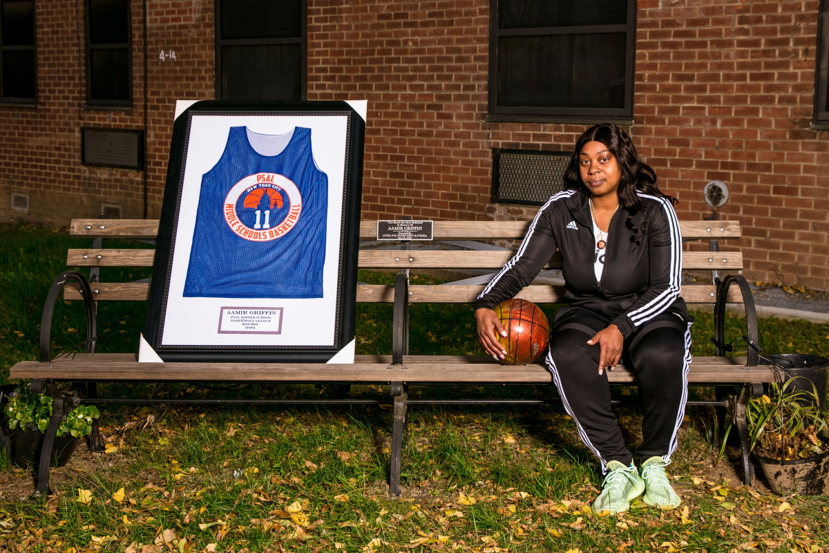 Aamir Griffin's mother, Shanequa, sits on a bench dedicated to her son.