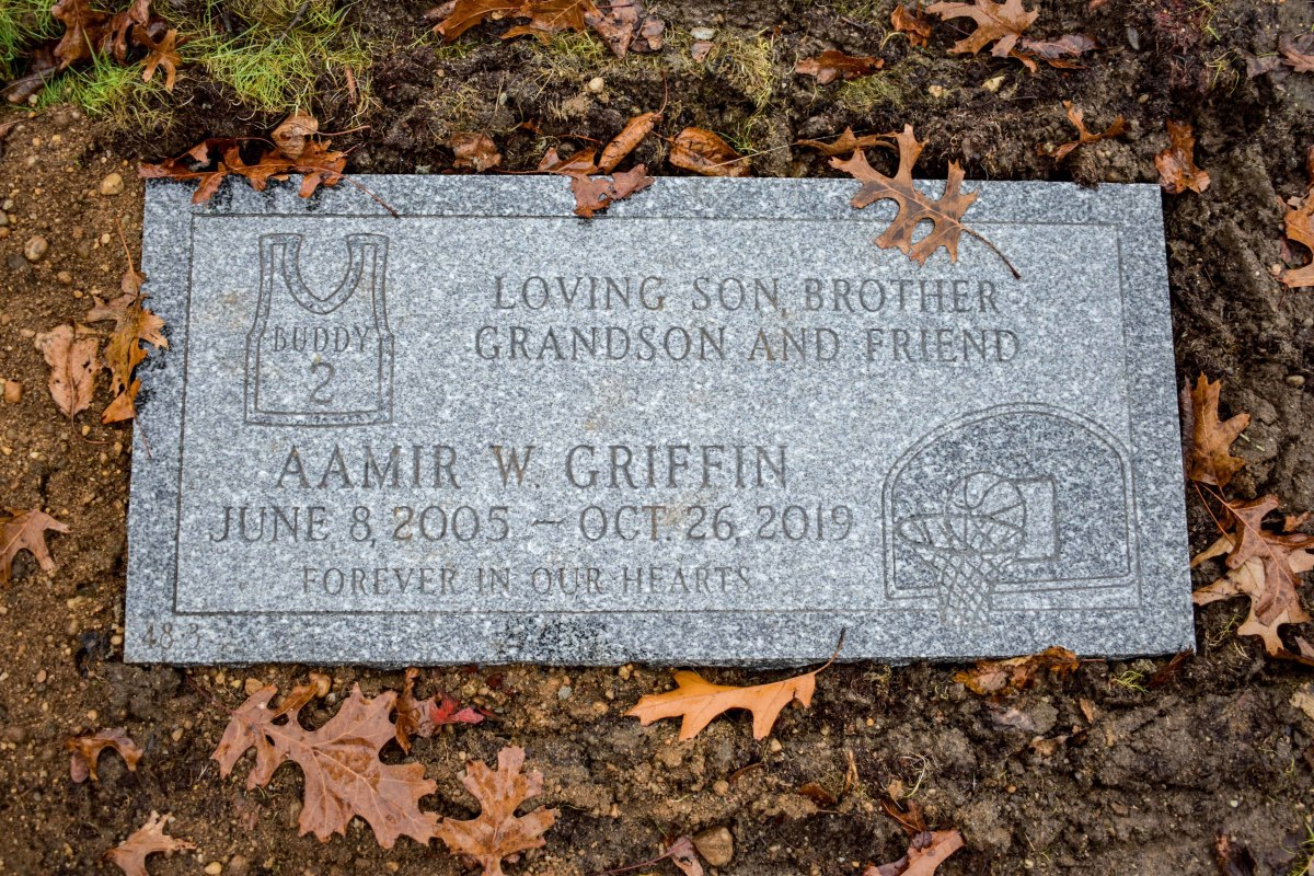 """An epitaph on Aamir's grave reads, """"LOVING SON, BROTHER, GRANDSON AND FRIEND."""""""