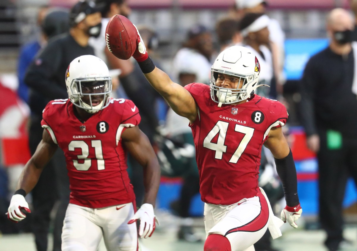 Arizona Cardinals linebacker Ezekiel Turner (47) celebrates after catching a pass on a fake punt play in the second half against the Philadelphia Eagles at State Farm Stadium.