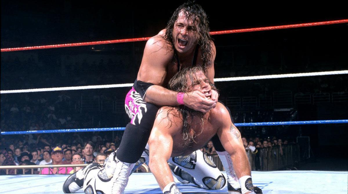 WWE's Bret Hart performs a submission maneuver on Shawn Michaels