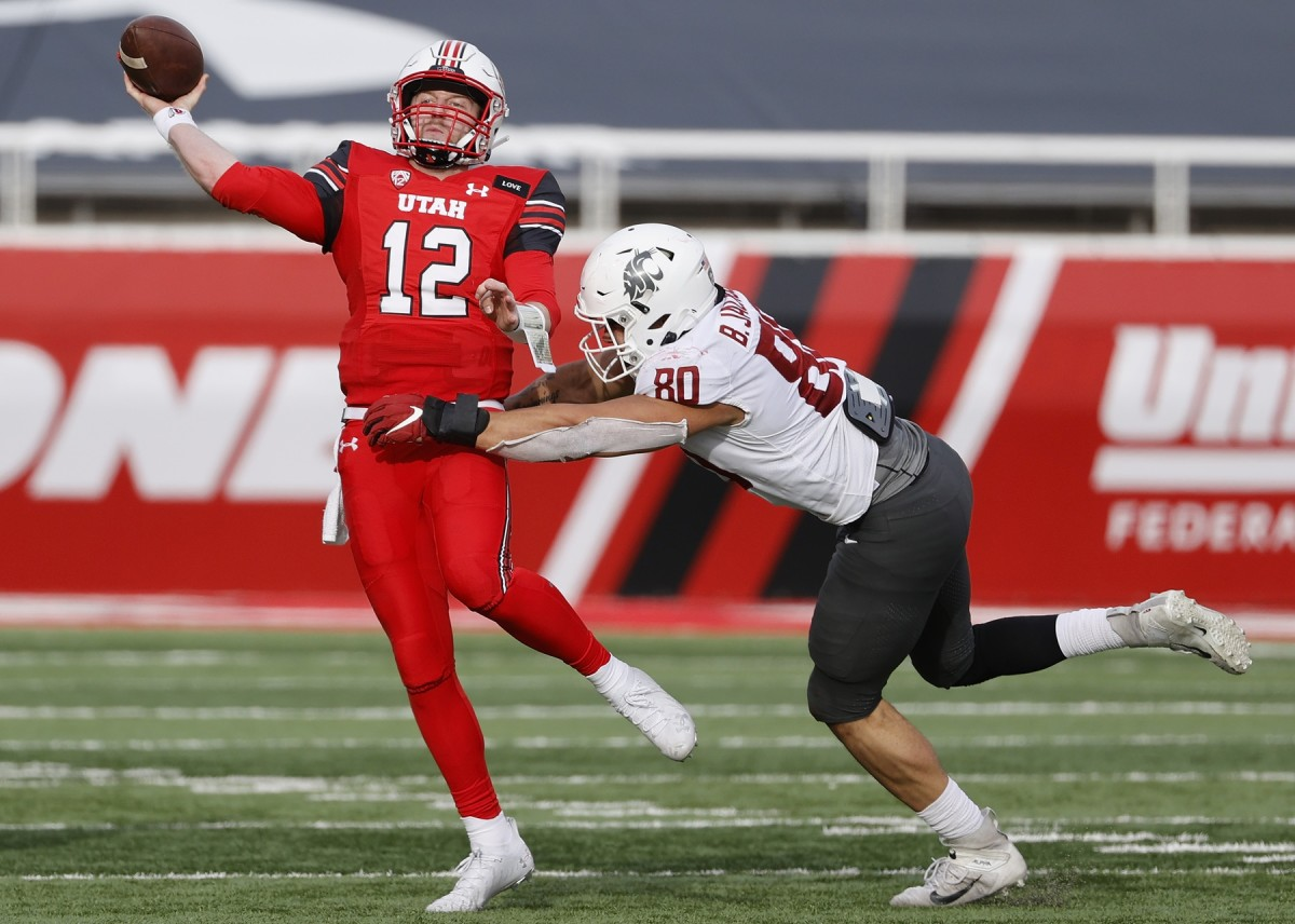 Dec 19, 2020; Salt Lake City, Utah, USA; Utah Utes quarterback Drew Lisk (12) passes under pressure by Washington State Cougars defensive end Brennan Jackson (80) in the fourth quarter at Rice-Eccles Stadium.