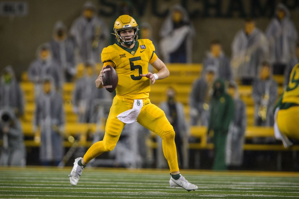 Nov 28, 2020; Waco, Texas, USA; Baylor Bears quarterback Charlie Brewer (5) rolls out against the Kansas State Wildcats during the first quarter at McLane Stadium.