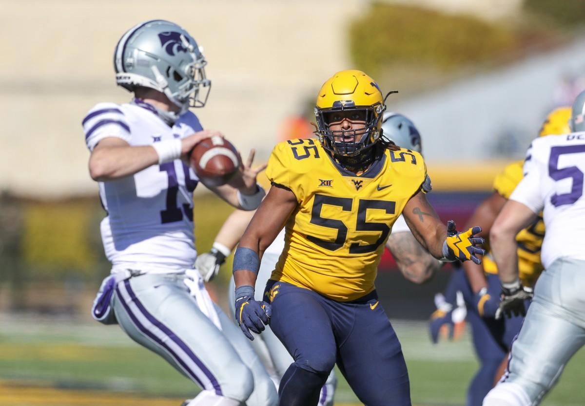 West Virginia Mountaineers defensive lineman Dante Stills (55) rushes Kansas State Wildcats quarterback Will Howard (15) during the second quarter at Mountaineer Field at Milan Puskar Stadium.