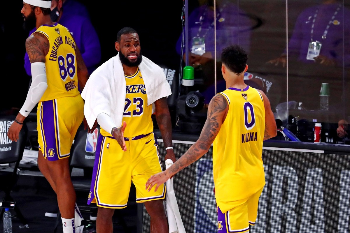 Sep 30, 2020; Orlando, Florida, USA; Los Angeles Lakers forward LeBron James (23) celebrates with forward Kyle Kuzma (0) during the fourth quarter against the Miami Heat in game one of the 2020 NBA Finals at AdventHealth Arena.