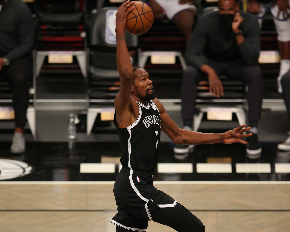 Brooklyn Nets forward Kevin Durant dunks against the Golden State Warriors during the third quarter at Barclays Center.