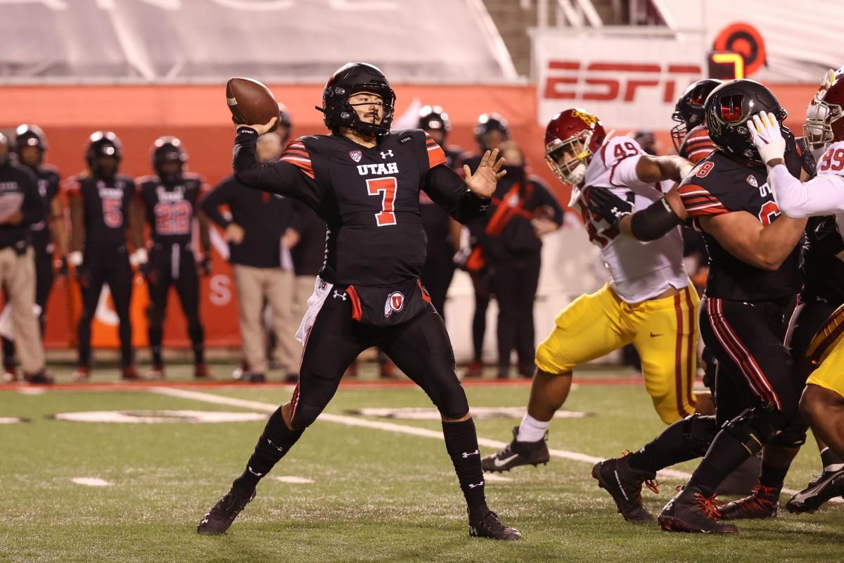 Nov 21, 2020; Salt Lake City, Utah, USA; Utah Utes quarterback Cameron Rising (7) throws the ball down the field against the USC Trojans during the first quarter at Rice-Eccles Stadium.