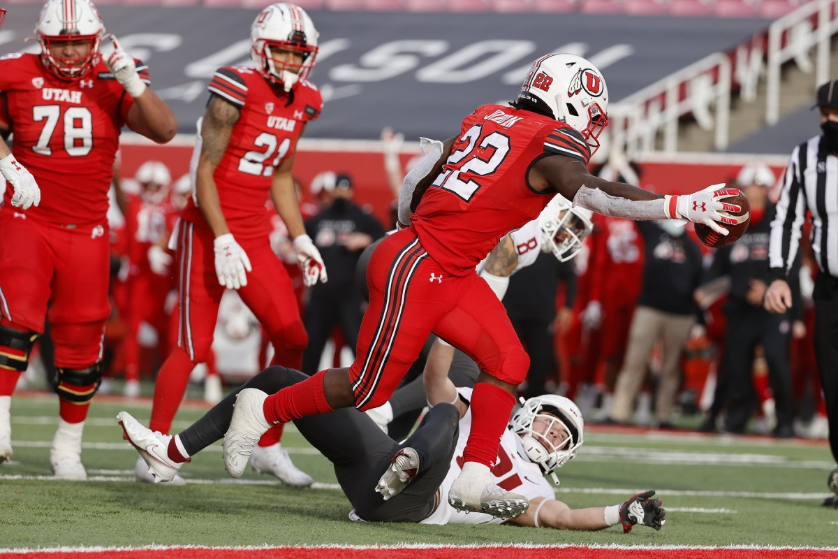 Dec 19, 2020; Salt Lake City, Utah, USA; Utah Utes running back Ty Jordan (22) runs in for a touchdown in the fourth quarter against the Washington State Cougars at Rice-Eccles Stadium.