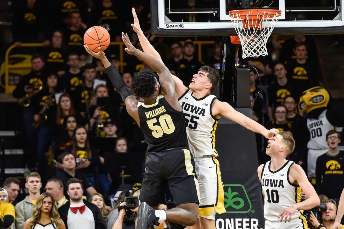 Iowa center Luka Garza (55) leads the Big Ten in scoring, averaging 29.3 points per game. (USA TODAY Sports)