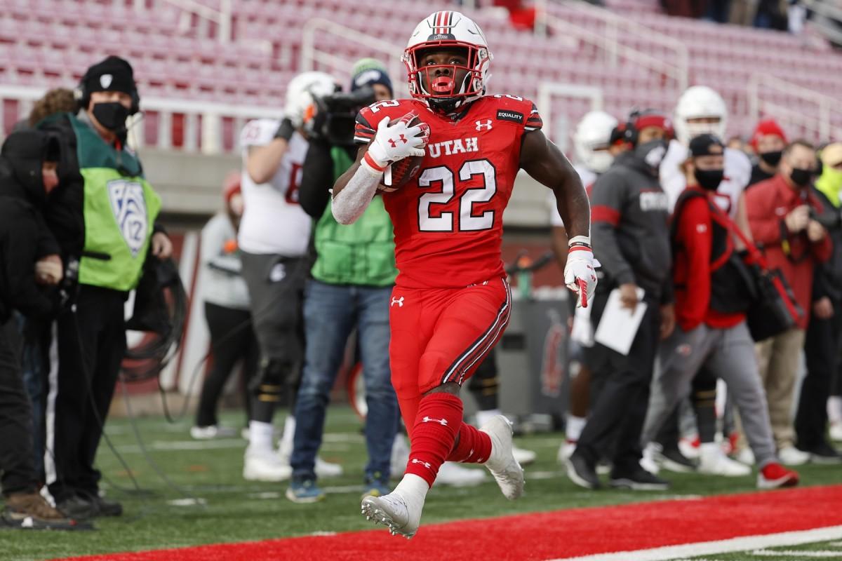 Dec 19, 2020; Salt Lake City, Utah, USA; Utah Utes running back Ty Jordan (22) runs in for a touchdown in the fourth quarter against the Washington State Cougars at Rice-Eccles Stadium.