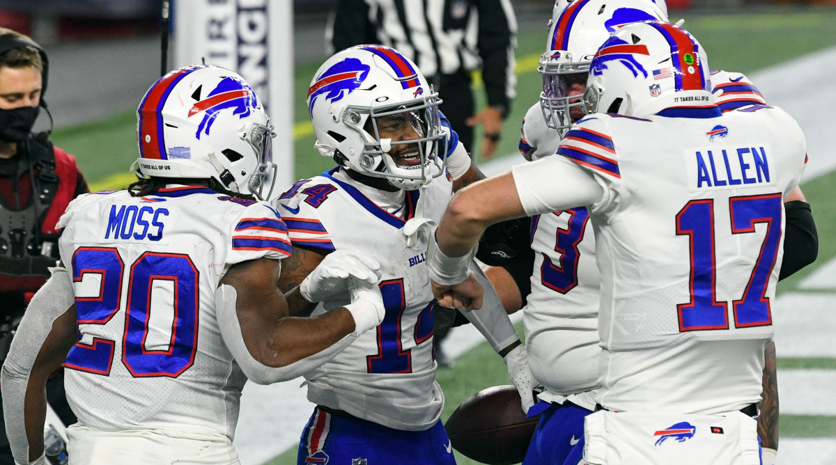 Buffalo Bills wide receiver Stefon Diggs celebrates with quarterback Josh Allen and running back Zack Moss after scoring a touchdown against the New England Patriots during the second half at Gillette Stadium.