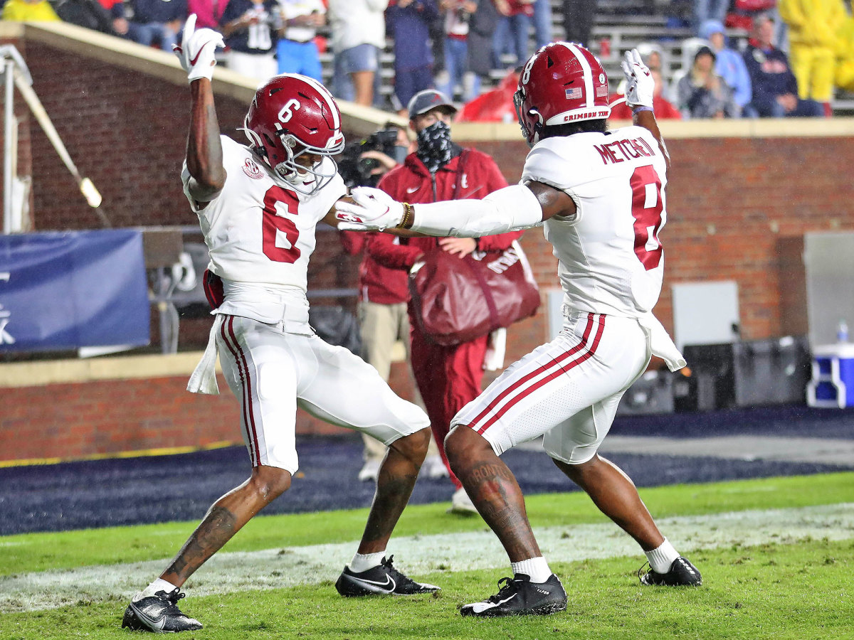 Alabama receivers DeVonta Smith and John Metchie III celebrate a touchdown