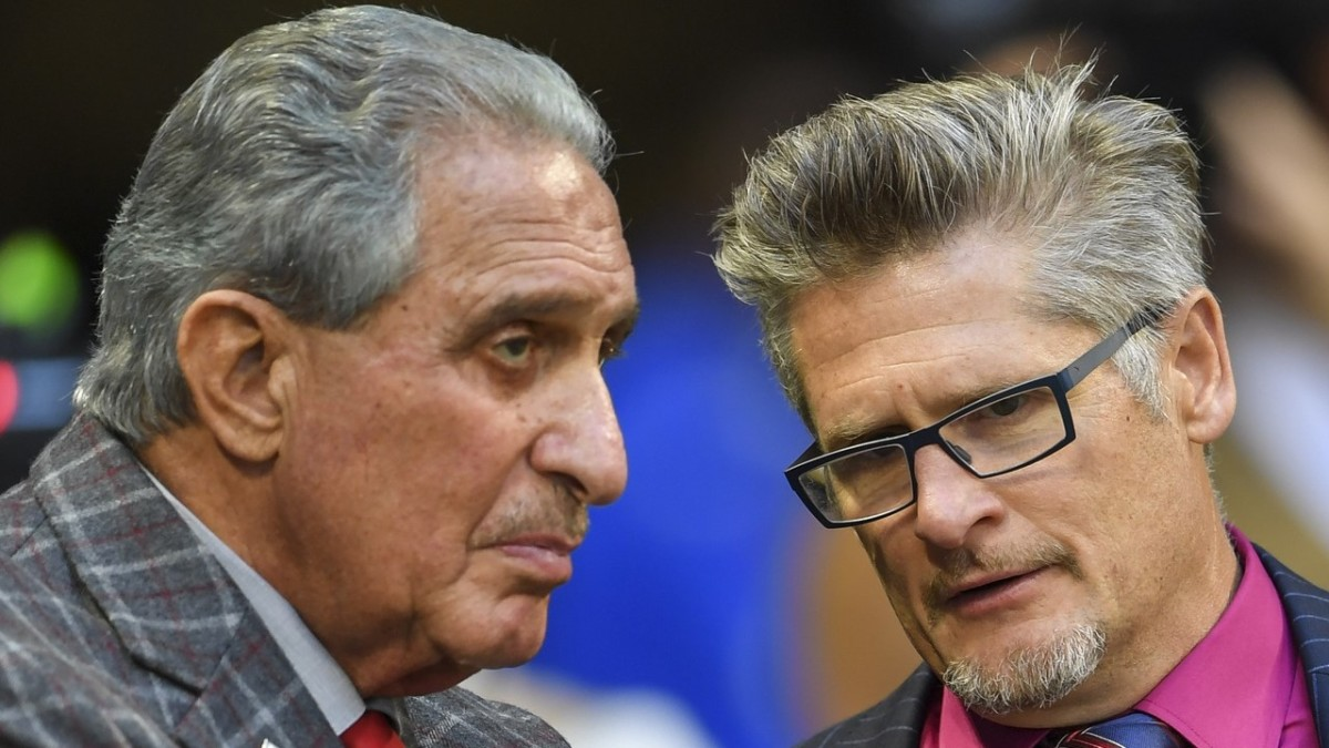 Falcons owner Arthur Blank (left) and Dimitroff talk on the sidelines during a game against the Los Angeles Rams.
