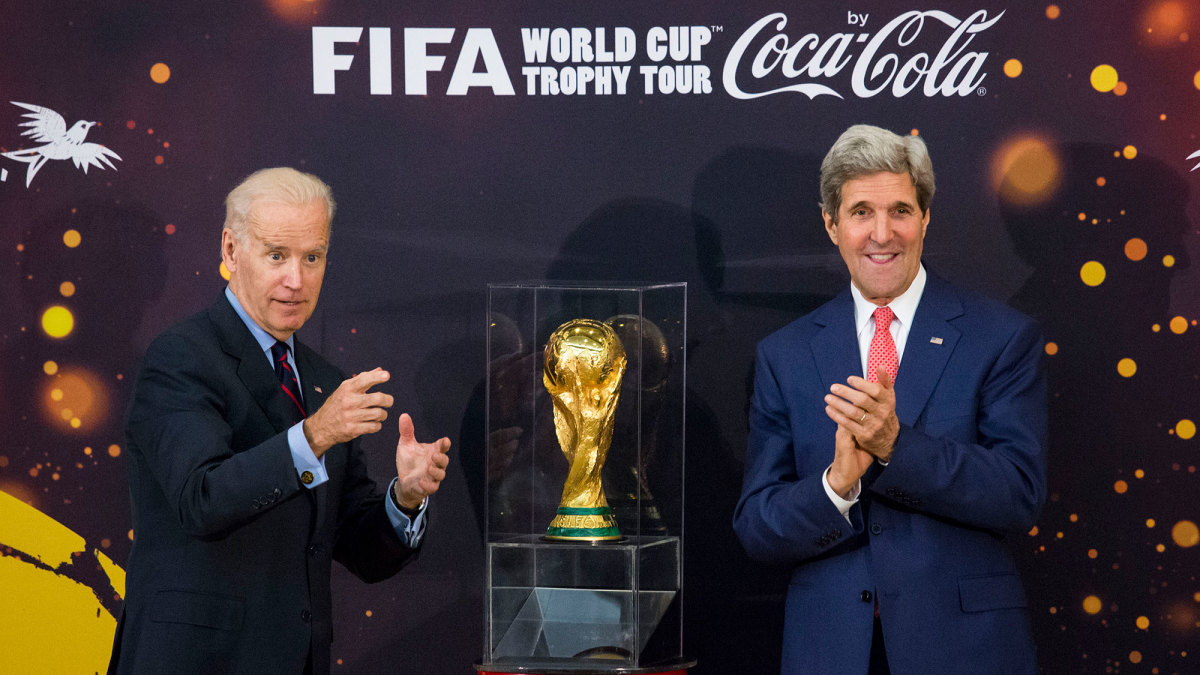 Joe Biden and John Kerry with the World Cup trophy