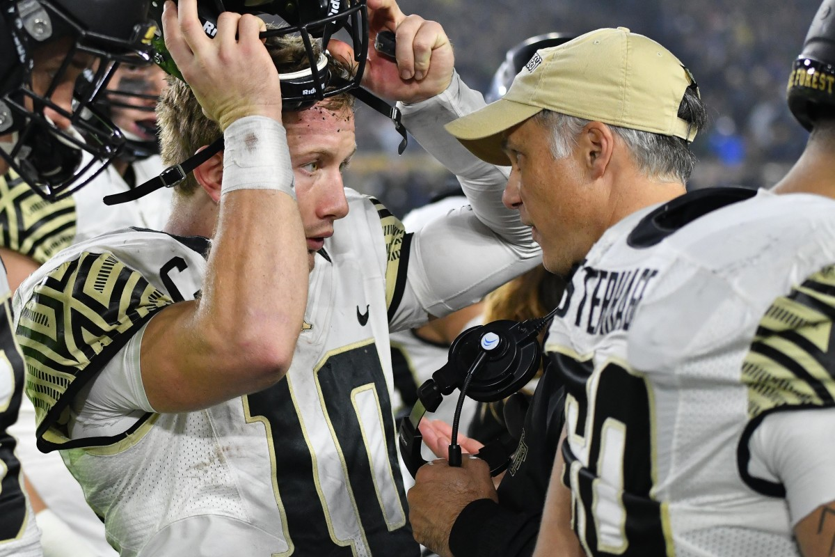 John Wolford talks with Wake Forest head coach Dave Clawson/USA Today