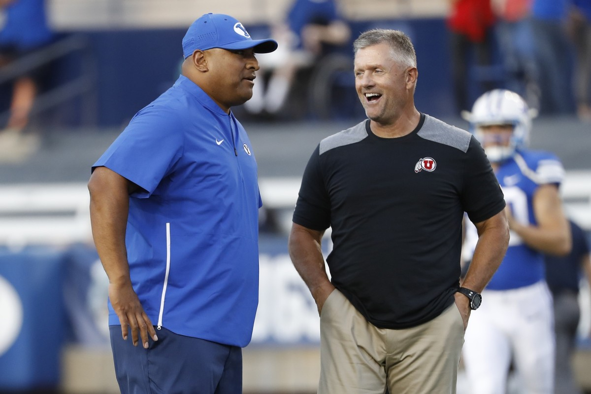 Aug 29, 2019; Provo, UT, USA; Brigham Young Cougars head coach Kalani Sitake, left and Utah Utes head coach Kyle Whittingham get together prior to their game at LaVell Edwards Stadium.