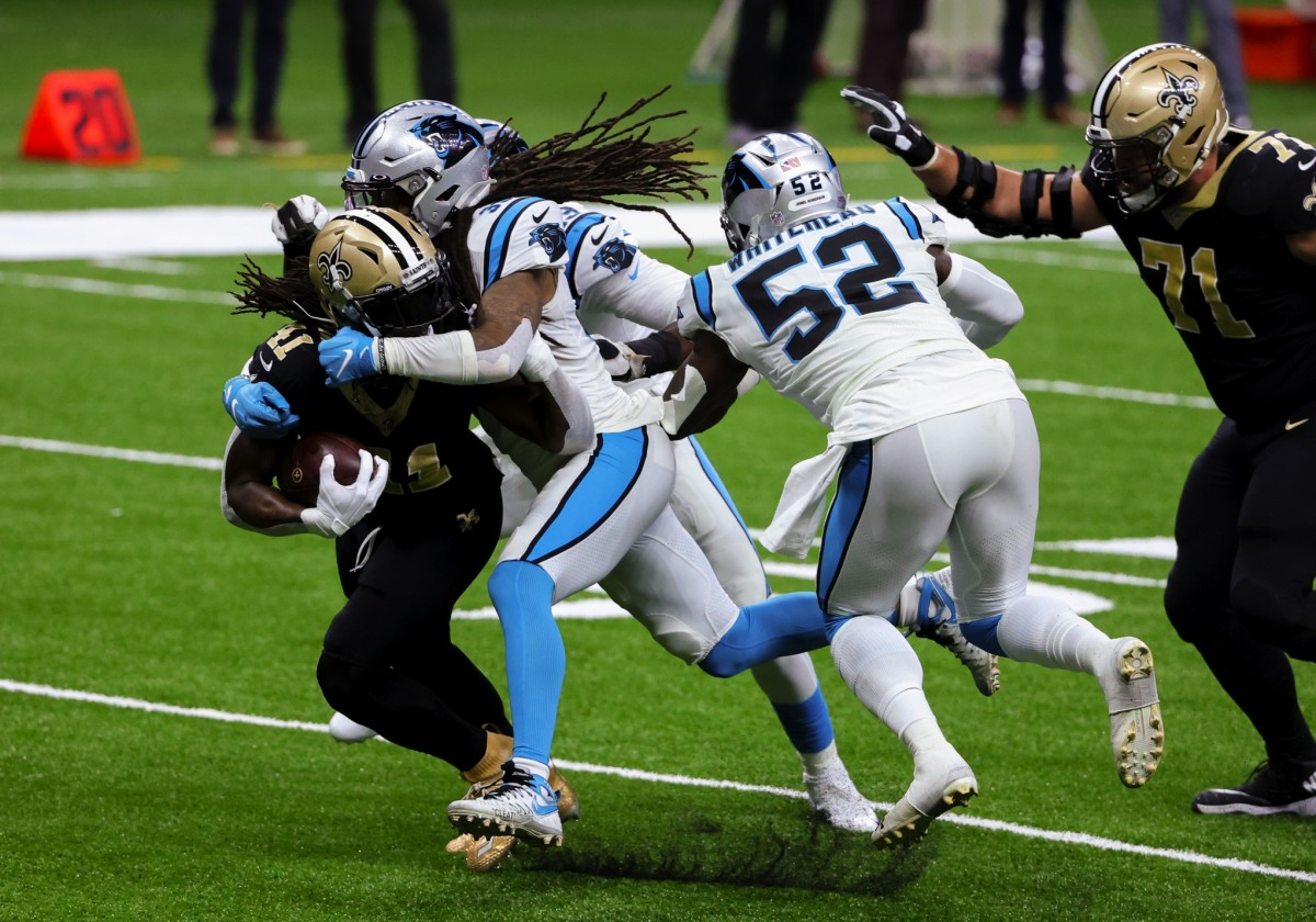 Oct 25, 2020; New Orleans, Louisiana, USA; Carolina Panthers free safety Tre Boston (33) tackles New Orleans Saints running back Alvin Kamara (41) during the second quarter at the Mercedes-Benz Superdome. Mandatory Credit: Derick E. Hingle-USA TODAY