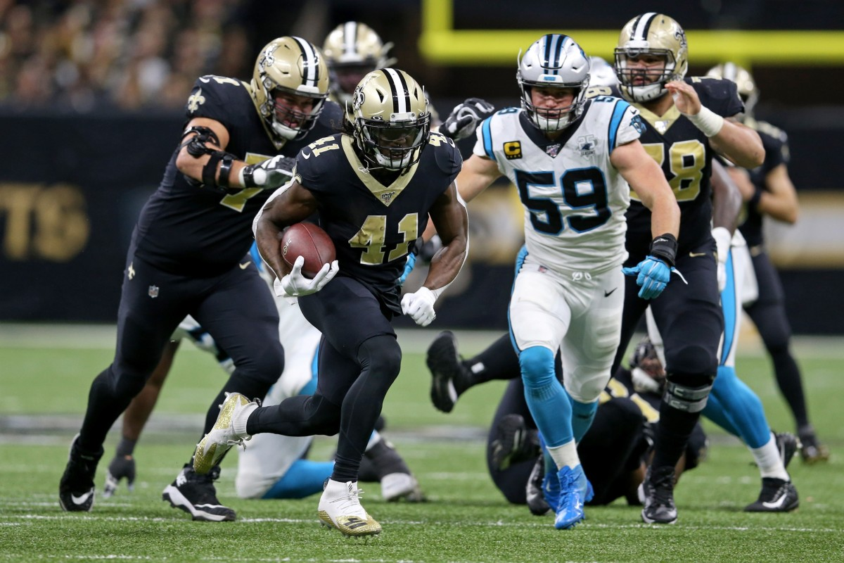 Nov 24, 2019; New Orleans, LA, USA; New Orleans Saints running back Alvin Kamara (41) runs against the Carolina Panthers in the second half at the Mercedes-Benz Superdome. The Saints won, 34-31. Mandatory Credit: Chuck Cook-USA TODAY