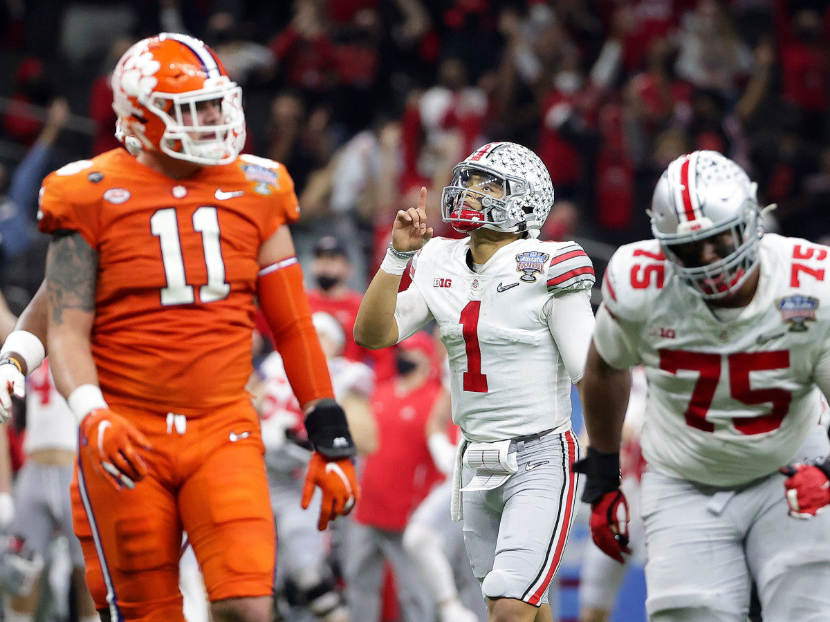 Justin Fields points to the sky after scoring a touchdown vs. Clemson