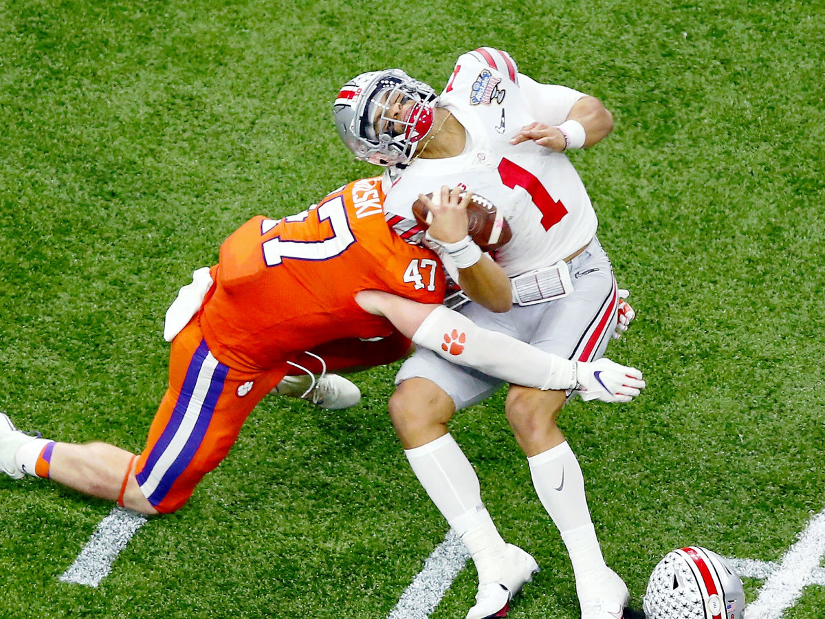 Clemson's James Skalski hits Justin Fields with a tackle that earned a targeting ejection