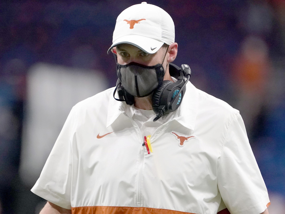 Dec 29, 2020; San Antonio, TX, USA; Texas Longhorns coach Tom Herman wears a face mask on the sidelines in the second half against the Colorado Buffaloes during the Alamo Bowl at the Alamodome.