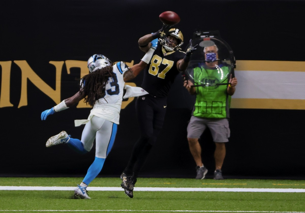Oct 25, 2020; New Orleans, Louisiana, USA; New Orleans Saints tight end Jared Cook (87) catches a touchdown over Carolina Panthers free safety Tre Boston (33) during the first quarter at the Mercedes-Benz Superdome. Mandatory Credit: Derick E. Hingle-USA TODAY Sports