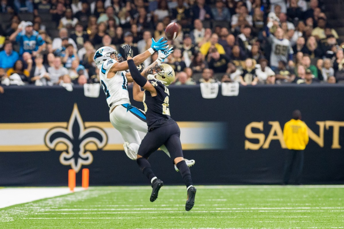 Saints corner back Marshon Lattimore breaks up a pass to Panthers receiver DJ Moore during the NFL football game between the New Orleans Saints and the Carolina Panthers in the Mecedes-Benz Superdome. SCOTT CLAUSE/USA TODAY Network