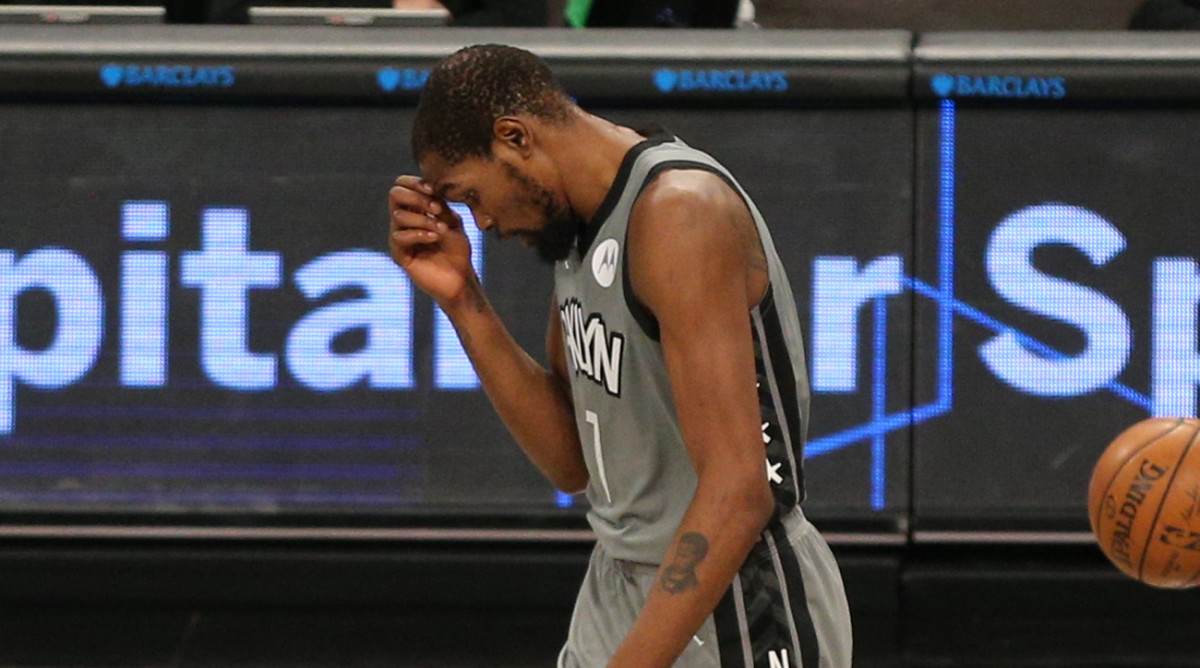 Brooklyn Nets small forward Kevin Durant (7) reacts after missing a pass that sailed out of bounds during the third quarter against the Washington Wizards at Barclays Center.