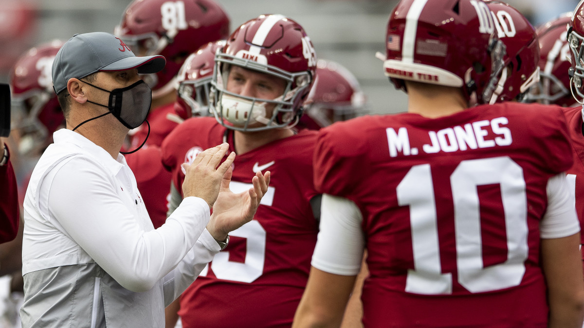 Alabama offensive coordinator Steve Sarkisian, acting as head coach during head coach Nick Saban's COVID-19 quarantine, takes the field with the team for warmups at Bryant-Denny Stadium for the Iron Bowl