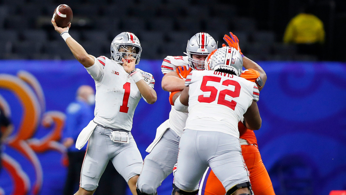 Ohio State Buckeyes quarterback Justin Fields (1) throws the ball against Clemson Tigers in the third quarter during the College Football Playoff semifinal at the Allstate Sugar Bowl