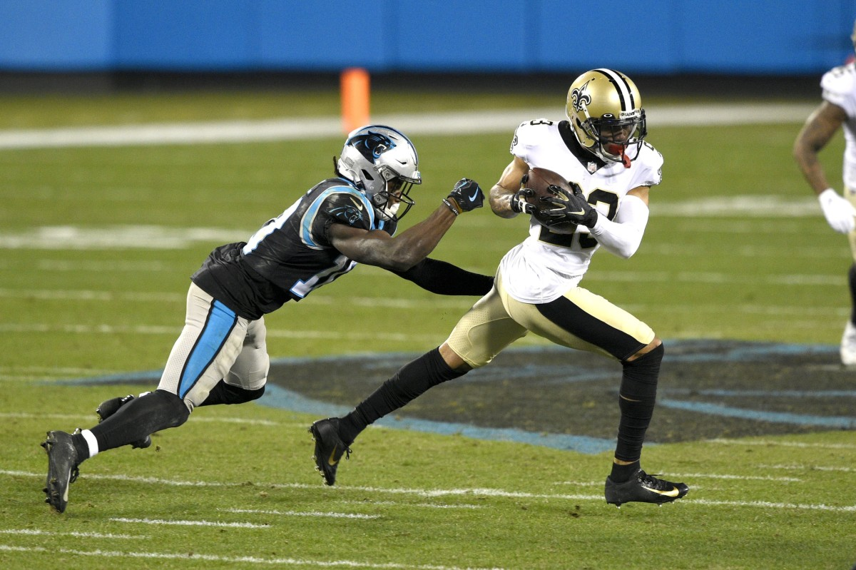 Jan 3, 2021; Charlotte, North Carolina, USA; New Orleans Saints cornerback Marshon Lattimore (23) intercepts a pass intended for Carolina Panthers wide receiver Curtis Samuel (10) in the third quarter at Bank of America Stadium. Mandatory Credit: Bob Donnan-USA TODAY