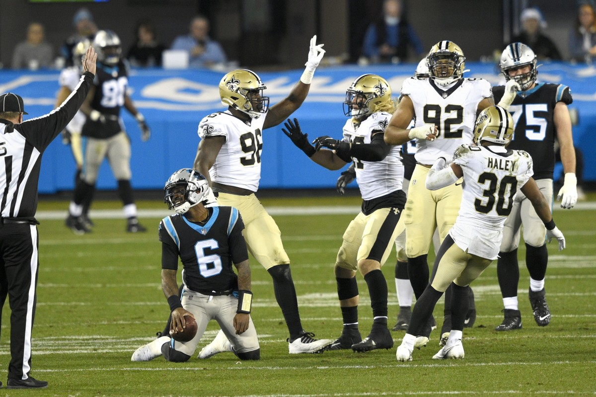 Jan 3, 2021; Charlotte, North Carolina, USA; Panthers quarterback P.J. Walker (6) is sacked by New Orleans Saints defensive end Carl Granderson (96) in the fourth quarter at Bank of America Stadium. Mandatory Credit: Bob Donnan-USA TODAY Sports