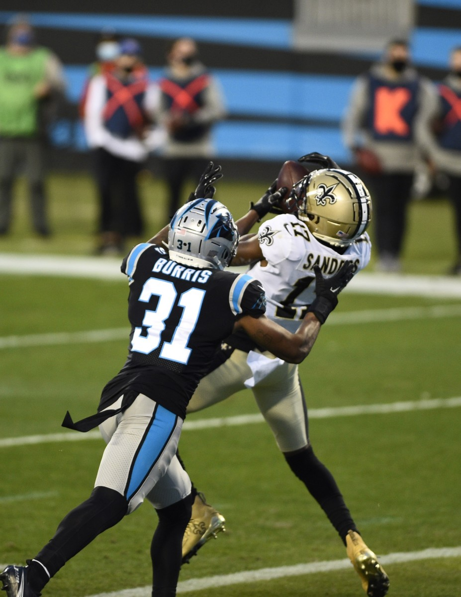 Jan 3, 2021; Charlotte, North Carolina, USA; New Orleans wide receiver Emmanuel Sanders (17) catches a touchdown as Panthers strong safety Juston Burris (31) defends in the second quarter at Bank of America Stadium. Mandatory Credit: Bob Donnan-USA TODAY