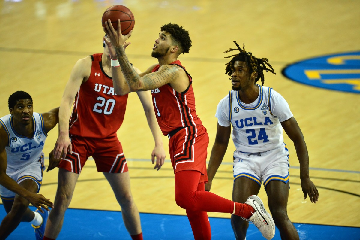 Dec 31, 2020; Los Angeles, California, CA; Utah Utes forward Timmy Allen (1) moves to the basket against UCLA Bruins guard Chris Smith (5) and forward Jalen Hill (24) during the second half at Pauley Pavilion.