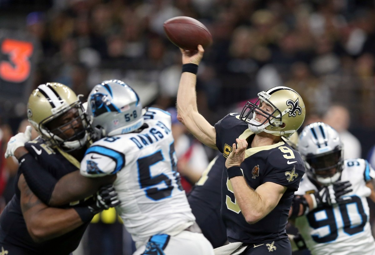 Jan 7, 2018; New Orleans, LA, USA; New Orleans Saints quarterback Drew Brees (9) makes a throw during the fourth quarter against the Carolina Panthers in the NFC Wild Card playoff football game at Mercedes-Benz Superdome. Mandatory Credit: Chuck Cook-USA TODAY
