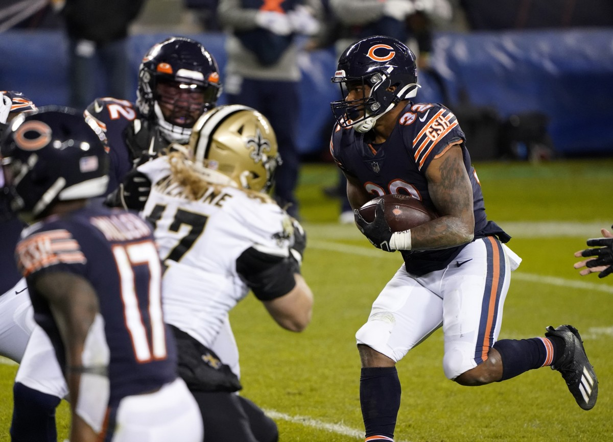 Nov 1, 2020; Chicago, Illinois, USA; Chicago Bears running back David Montgomery (32) rushes the ball against the New Orleans Saints during the fourth quarter at Soldier Field. Mandatory Credit: Mike Dinovo-USA TODAY