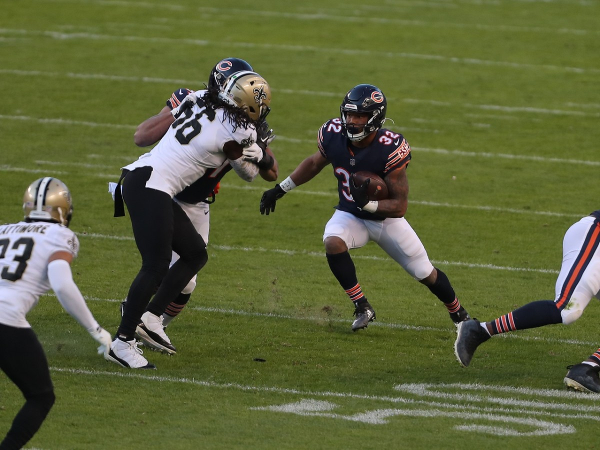 Nov 1, 2020; Chicago, Illinois, USA; Chicago Bears running back David Montgomery (32) runs with the ball during the first quarter against the New Orleans Saints at Soldier Field. Mandatory Credit: Dennis Wierzbicki-USA TODAY Sports
