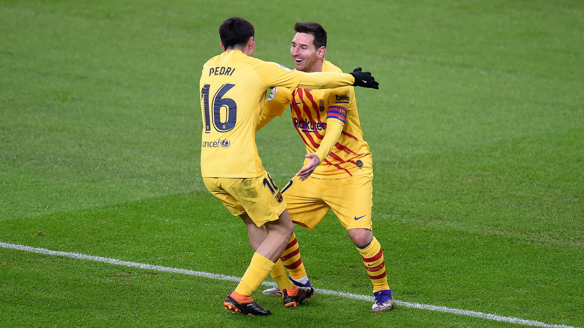 Pedri and Lionel Messi after a Barcelona goal