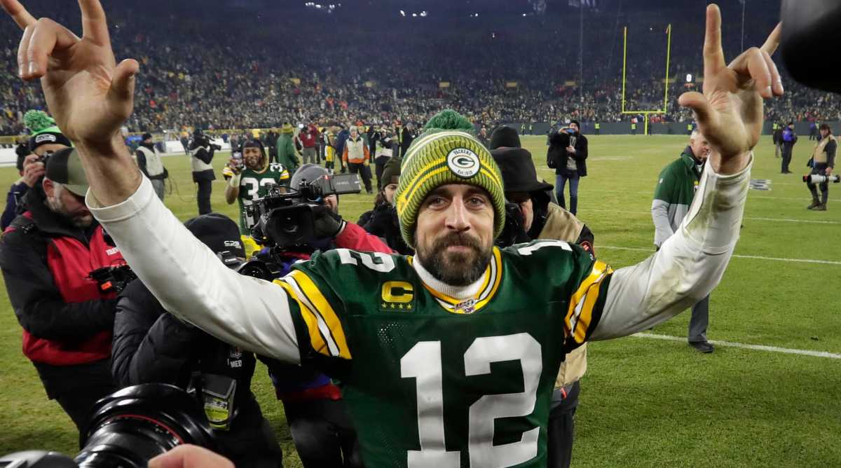 Aaron Rodgers celebrates the Packers' 28-23 win over the Seattle Seahawks in January 2020 to advance to the conference championship.