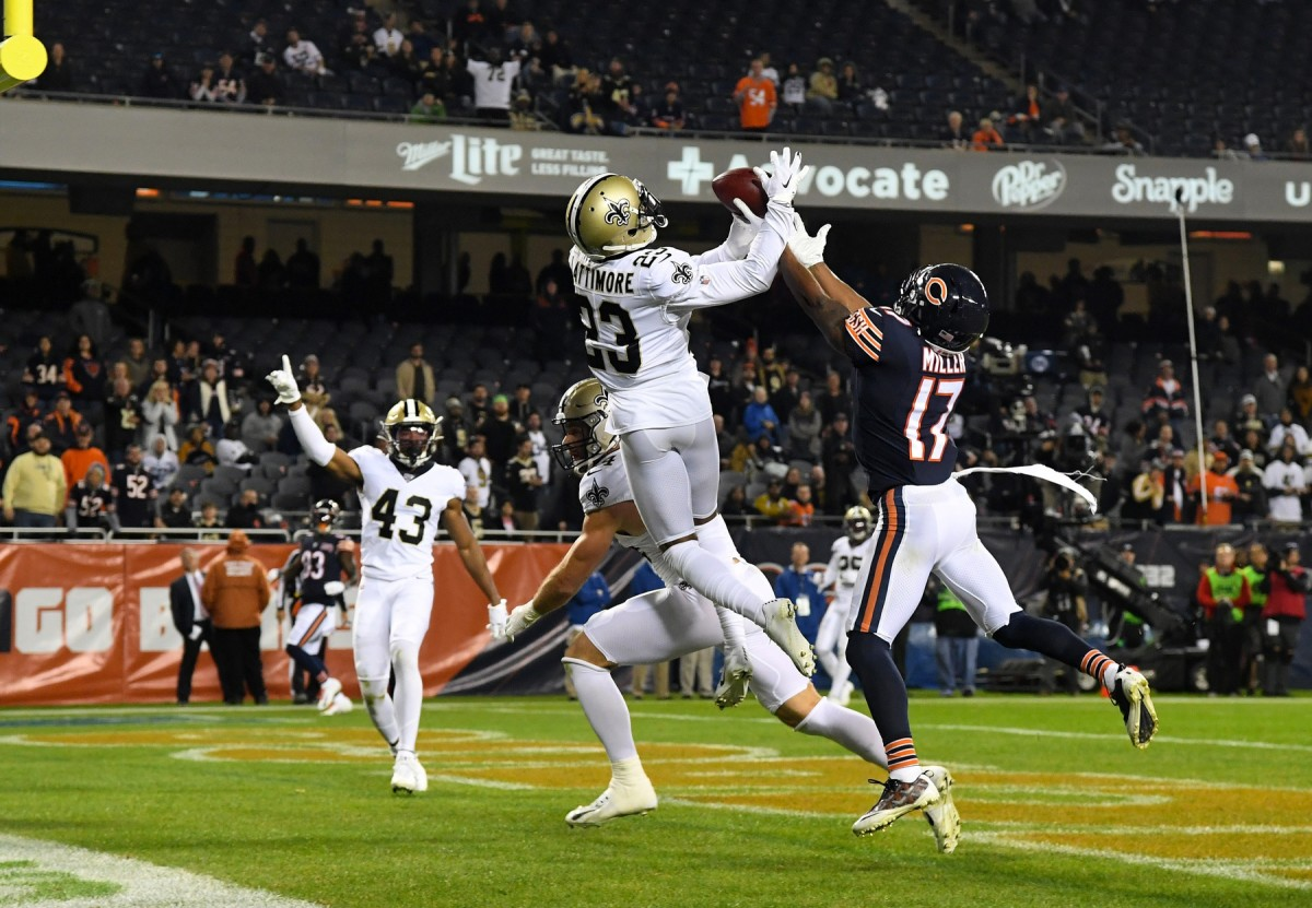 Oct 20, 2019; Chicago, IL, USA; New Orleans Saints cornerback Marshon Lattimore (23) and Chicago Bears wide receiver Anthony Miller (17) attempt to make a play on the ball during the second half at Soldier Field. Mandatory Credit: Mike DiNovo-USA TODAY Sports