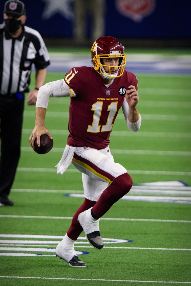 Nov 26, 2020; Arlington, Texas, USA; Washington Football Team quarterback Alex Smith (11) in action during the game between the Dallas Cowboys and the Washington Football Team at AT&T Stadium.