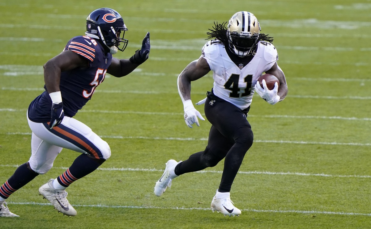 Nov 1, 2020; Chicago, Illinois, USA; New Orleans Saints running back Alvin Kamara (41) rushes the ball against the Chicago Bears during the first quarter at Soldier Field. Mandatory Credit: Mike Dinovo-USA TODAY
