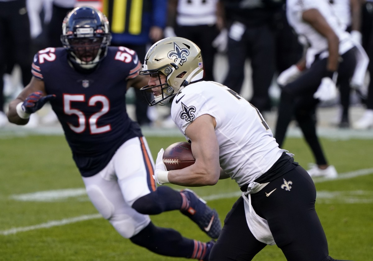 Nov 1, 2020; Chicago, Illinois, USA; New Orleans Saints quarterback Taysom Hill (7) rushes the ball against the Chicago Bears during the first quarter at Soldier Field. Mandatory Credit: Mike Dinovo-USA TODAY
