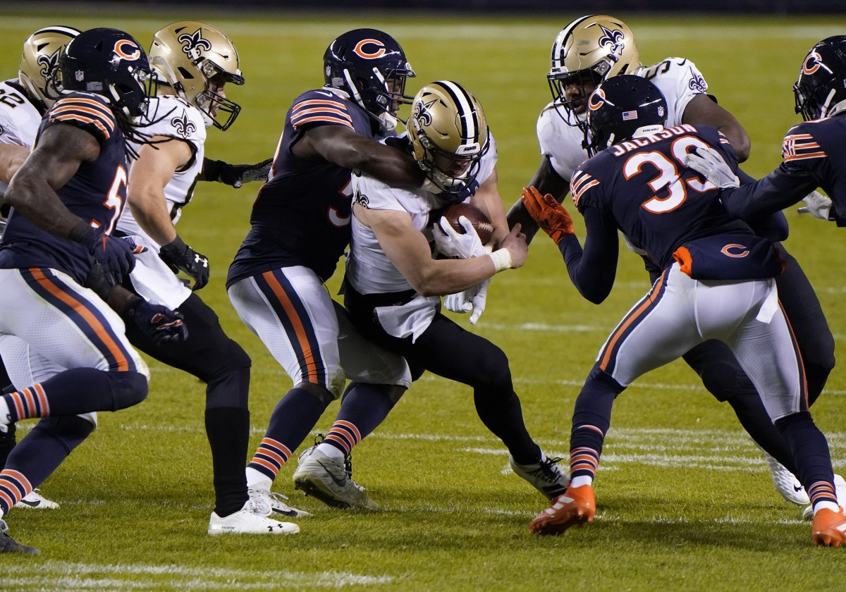 Nov 1, 2020; Chicago, Illinois, USA; Chicago Bears inside linebacker Roquan Smith (58) makes a tackle on New Orleans Saints quarterback Taysom Hill (7) during the third quarter at Soldier Field. Mandatory Credit: Mike Dinovo-USA TODAY