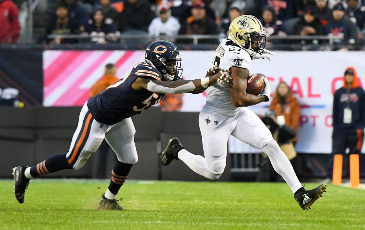 Oct 20, 2019; Chicago, IL, USA; New Orleans Saints running back Dwayne Washington (27) rushes the ball against Chicago Bears inside linebacker Danny Trevathan (59) during the second half at Soldier Field. Mandatory Credit: Mike DiNovo-USA TODAY
