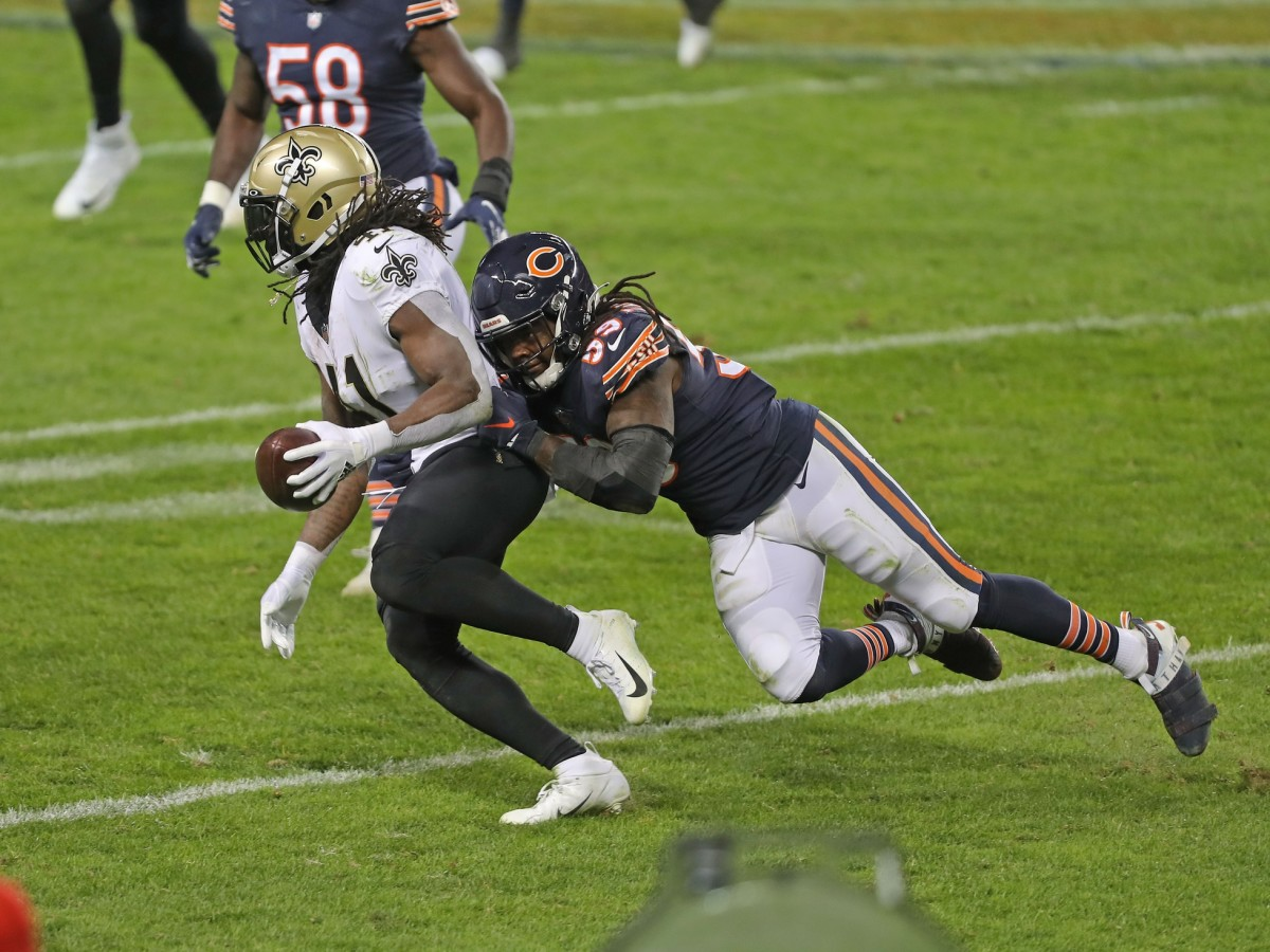 Nov 1, 2020; Chicago, Illinois, USA; New Orleans Saints running back Alvin Kamara (41) is tackled by Chicago Bears inside linebacker Danny Trevathan (59) during the second half at Soldier Field. Mandatory Credit: Dennis Wierzbicki-USA TODAY