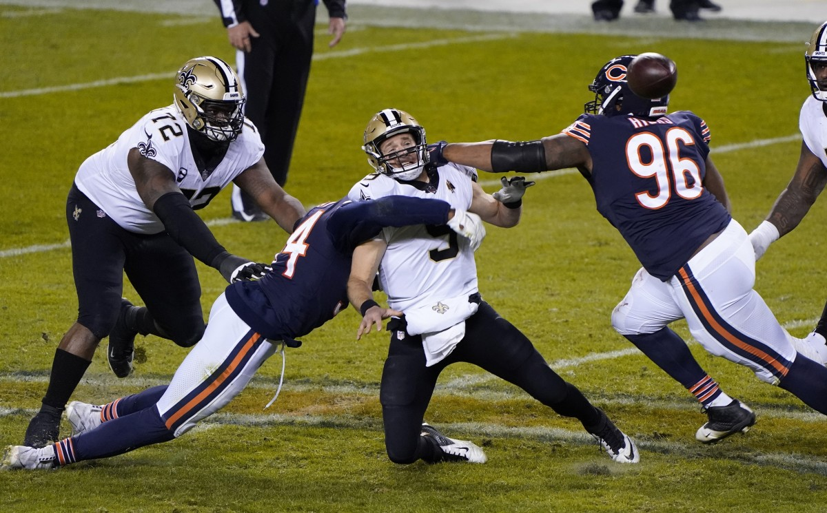 Nov 1, 2020; Chicago, Illinois, USA; Chicago Bears defensive end Akiem Hicks (96) puts pressure on New Orleans Saints quarterback Drew Brees (9) during the fourth quarter at Soldier Field. Mandatory Credit: Mike Dinovo-USA TODAY Sports